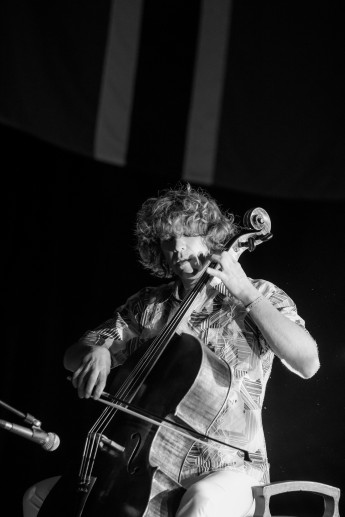 Erich-Oskar-Huetter-Portrait-with-cello-bw